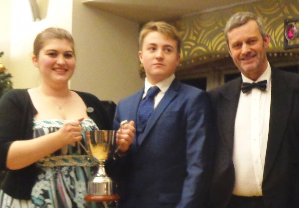 The Spring Open Cold Finger Trophy (over two races) – Club Lady's Captain Alice Frobisher and Ieuan Williams who also won Spring Open Cold Finger Trophy Lady's Cup, pictured with the Commodore.